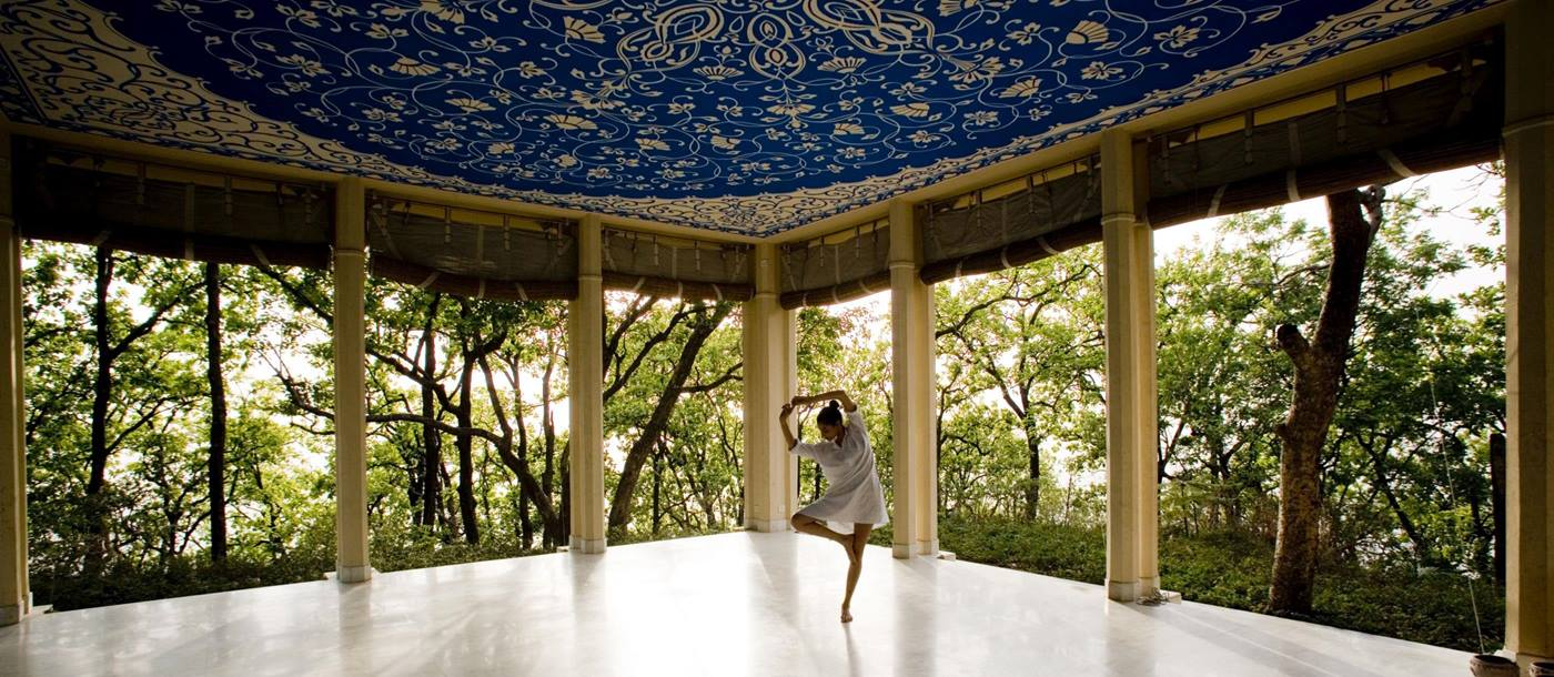 girl dancing in the yoga pavilion at Ananda, India
