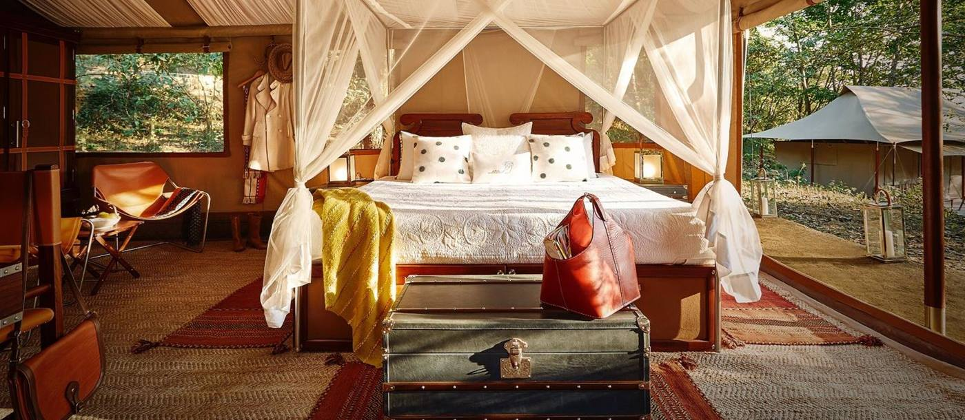 A four poster bed inside a tented bedroom at the Kohima Camp located at the foothills of  Japfu Mountain in Nagaland, India