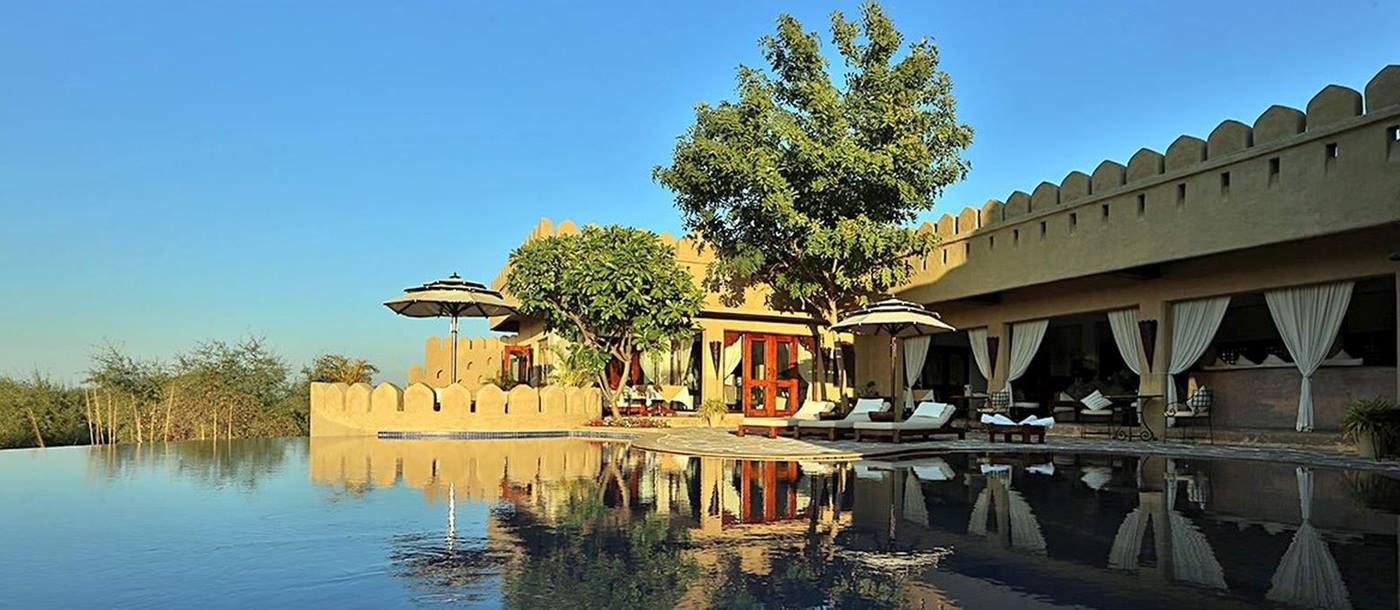 The swimming pool at Mihir Garh hotel in India