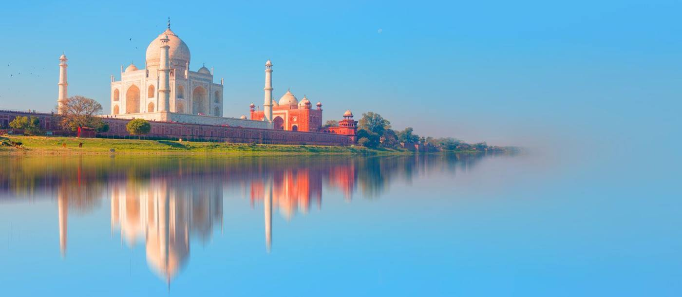 Distant view of the Taj Mahal in reflection