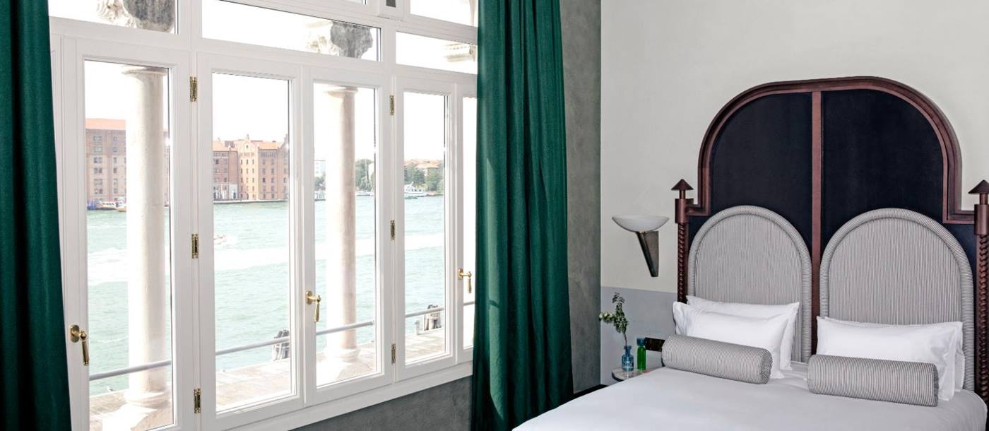 Guest room with views of the canal at Il Palazzo Experimental in Venice