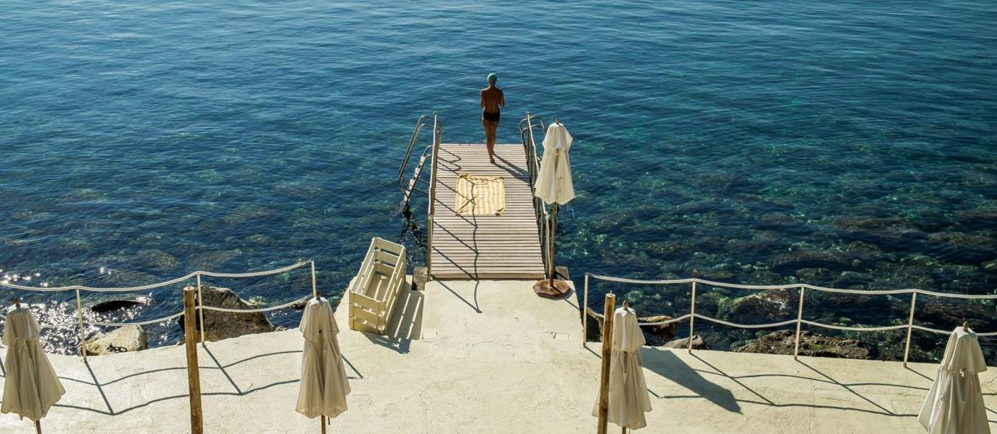 Jetty leading to sea at Il Pellicano