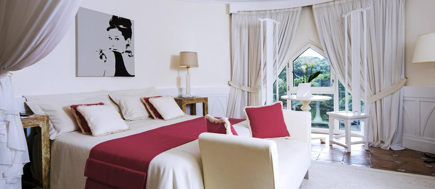 Classic suite bedroom at Mezzatore Resort and Spa, Italy