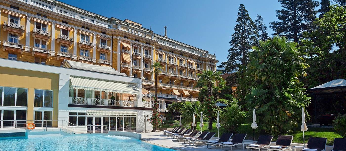 Swimming pool and facade of Palace Merano, Italy