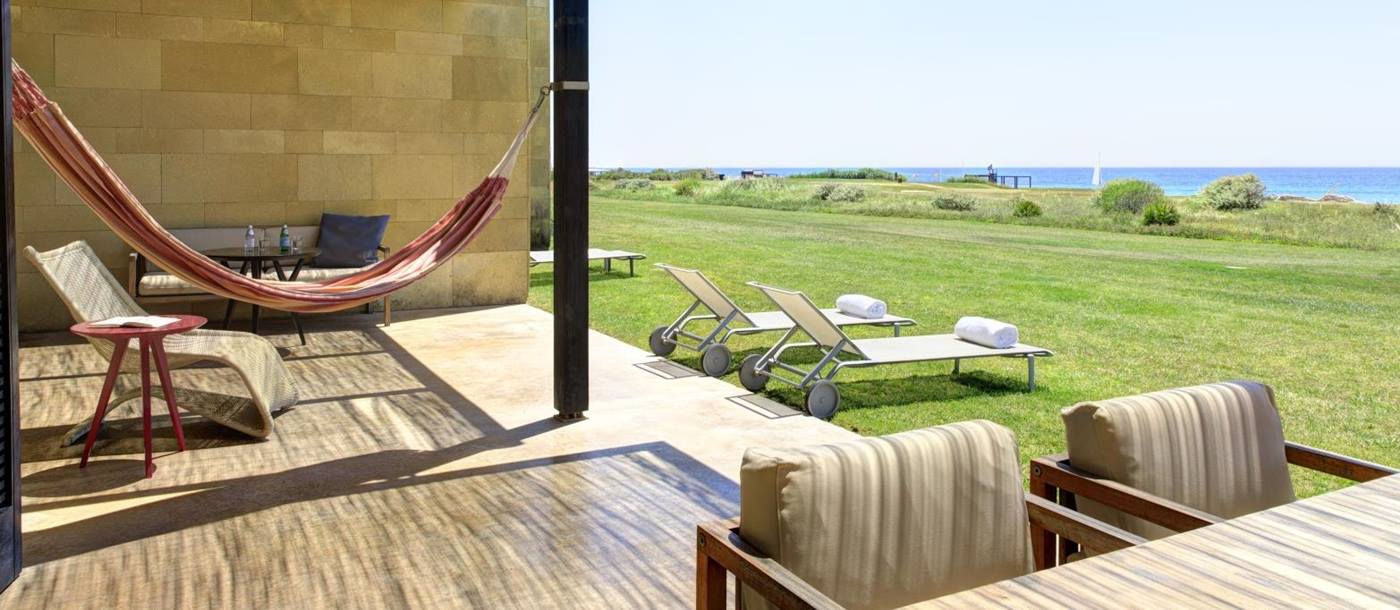 Grand Suite Terrace view with hammock at Verdura Resort in Italy