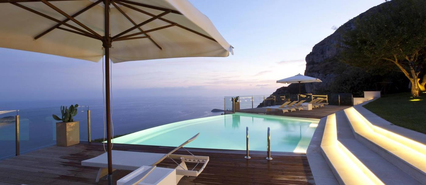 infinity pool at night at ensuite master bedroom in Villa li Galli, Amalfi Coast