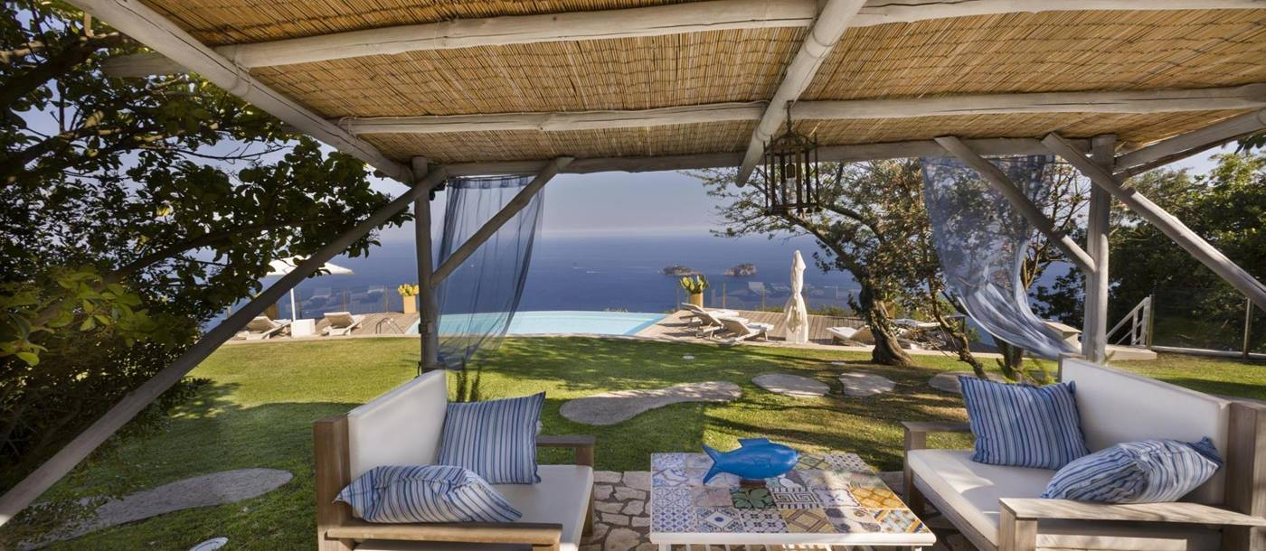 the covered outdoor seating area at ensuite master bedroom in Villa li Galli, Amalfi Coast