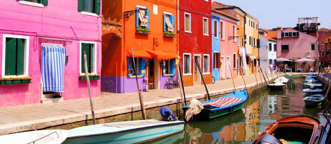 Colourful houses next to Canal in Venice
