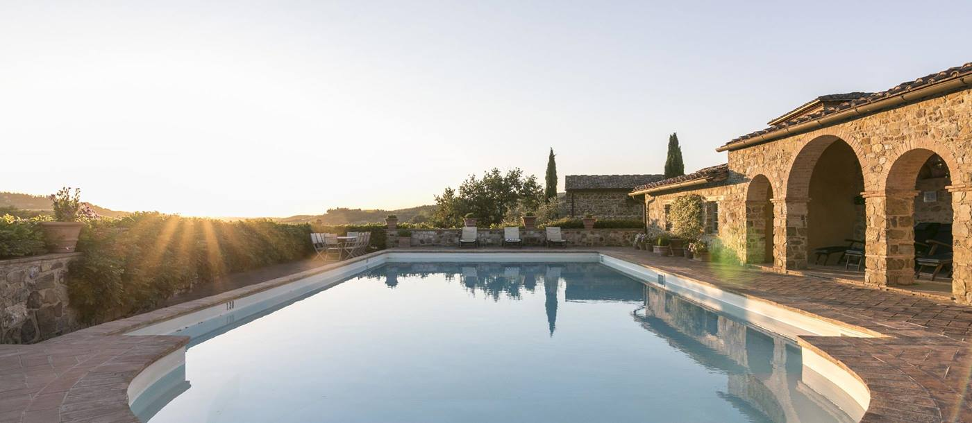 Swimming pool during sunset of Podere Cipressi, Tuscany