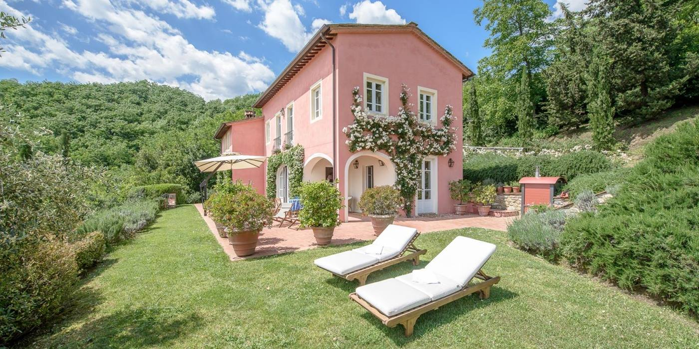 Two sun loungers and facade of Villa Barboleta, Tuscany