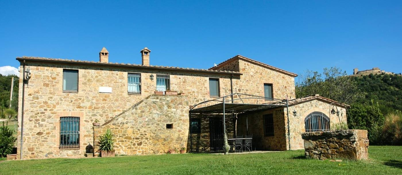Exterior of villa with blue sky at Villa dell Abate in Tuscany