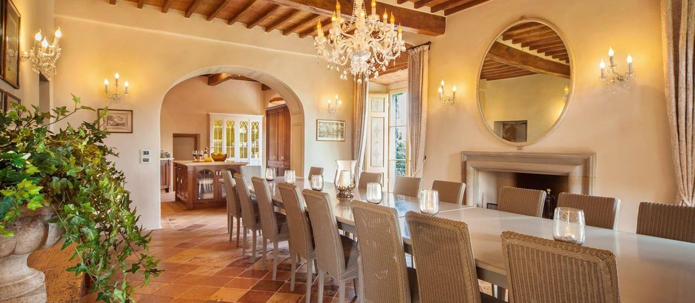 Well lit open dining room with chandelier in Villa Nocciola, Tuscany