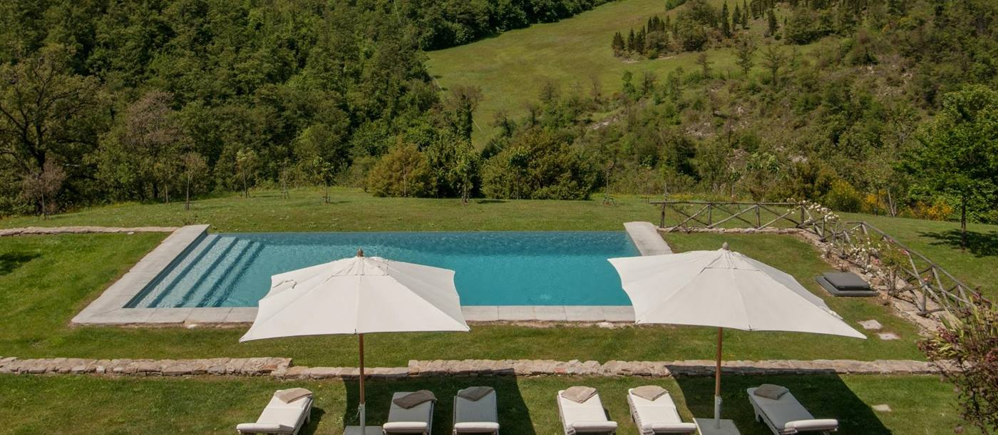 Swimming pool and view over the hills near Il Falco, Umbria