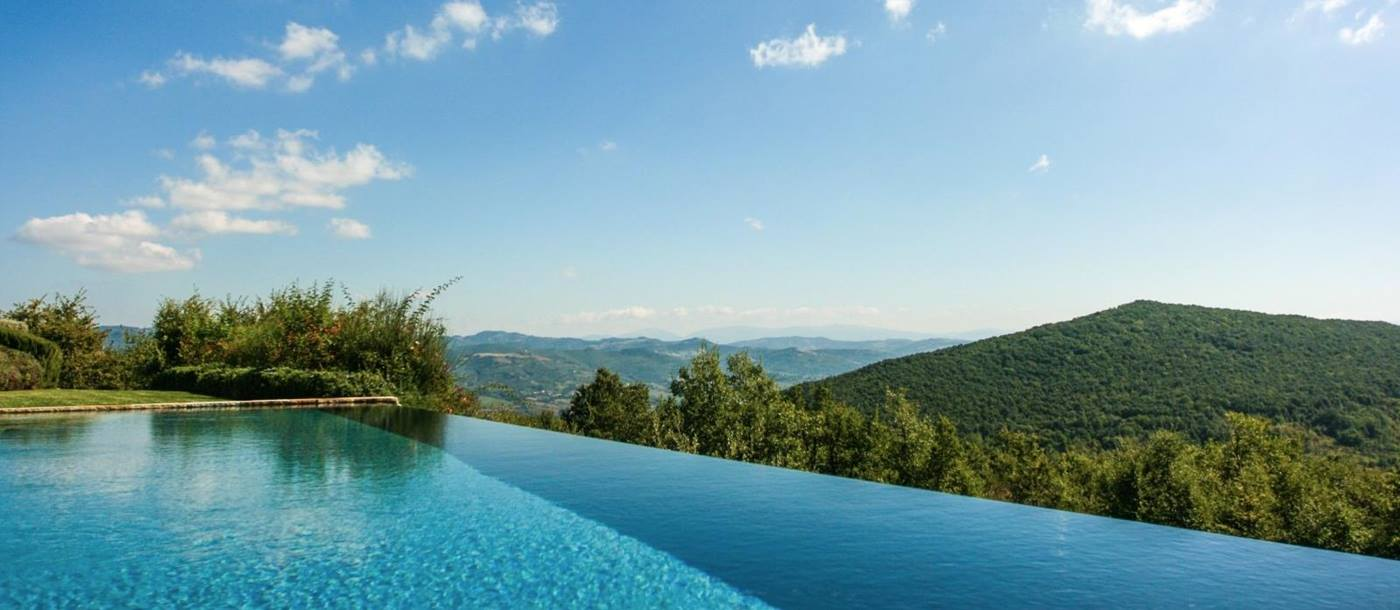 Infinity pool with countryside view at Monticello in Umbria, Italy