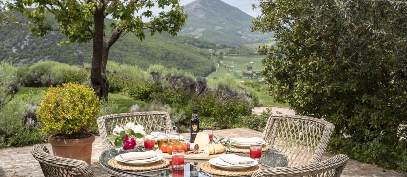 Outdoor dining with a view at Villa Arpeggio, Umbria