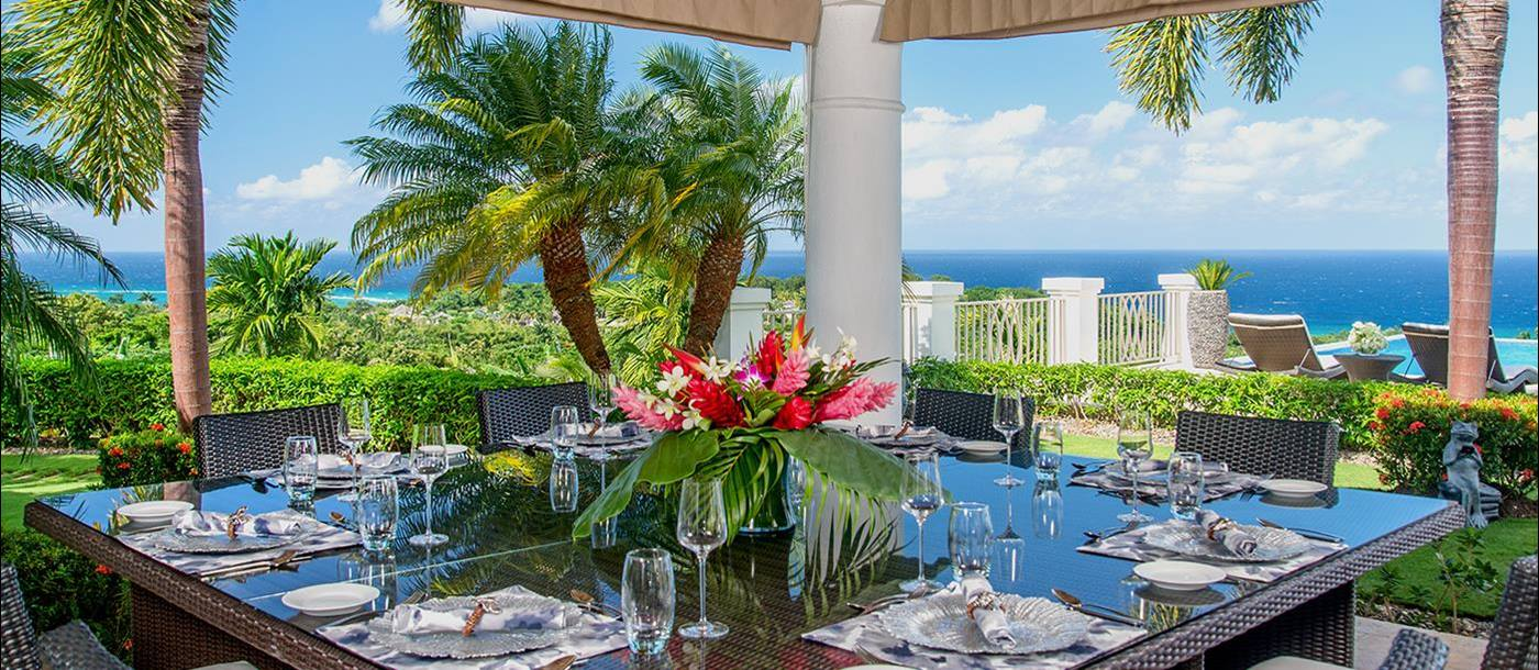 Outdoor dining with sea views at Harmony Hill in Jamaica