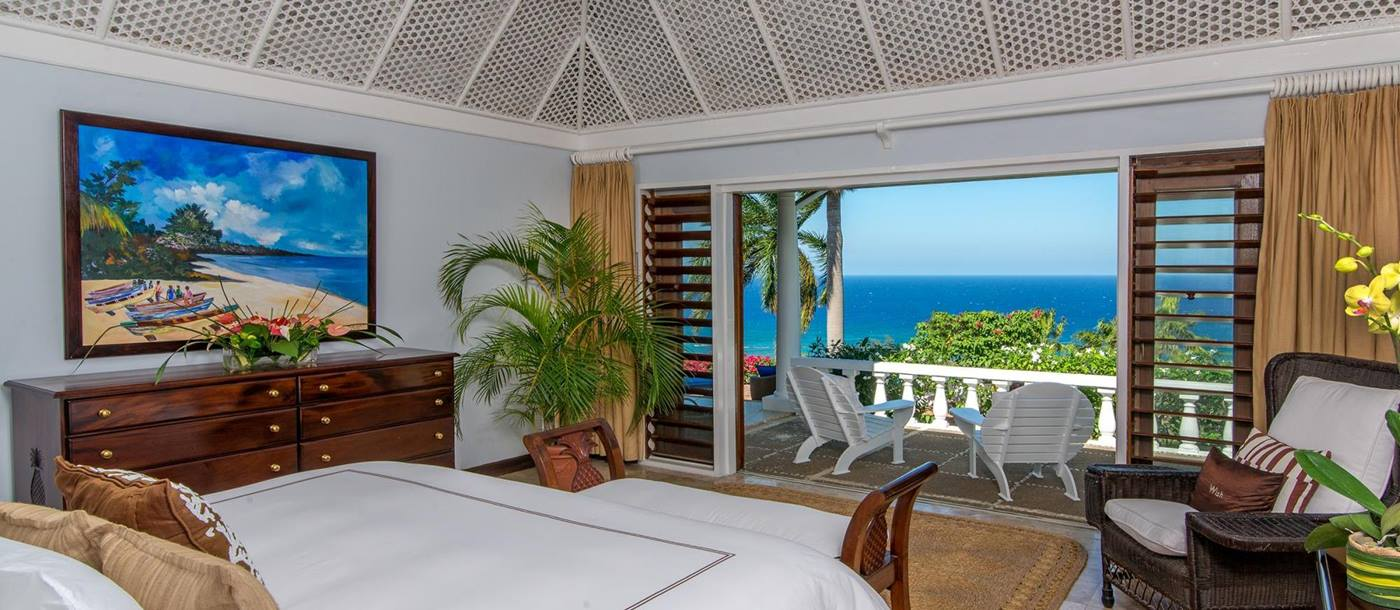 Double bedroom with terrace access in Villa Casuarina, Jamaica