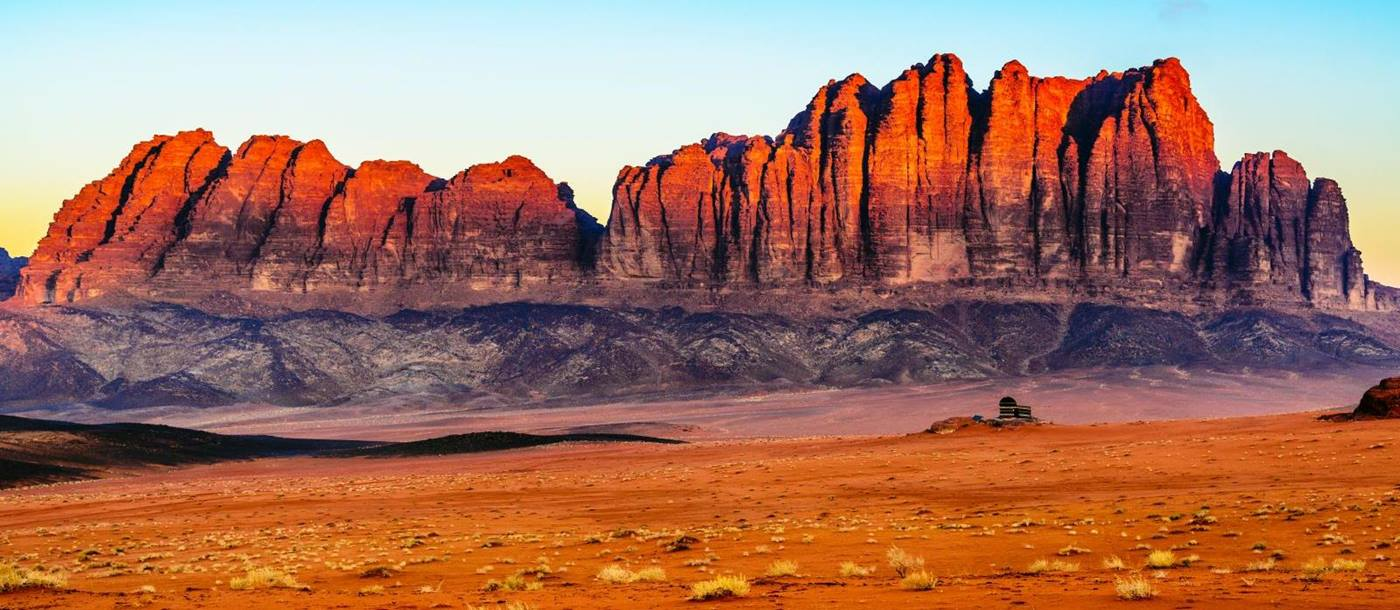Panorama of the red sand and red cliffs of Wadi Rum in Jordan