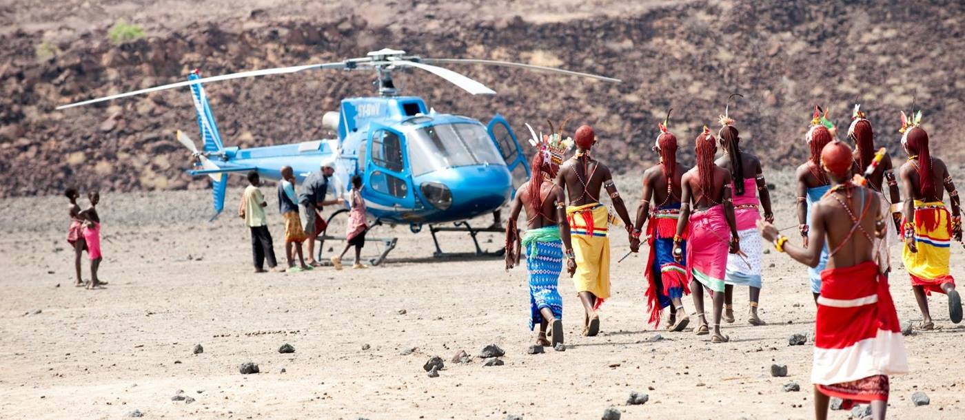 Kenyans coming to greet visting helicopter