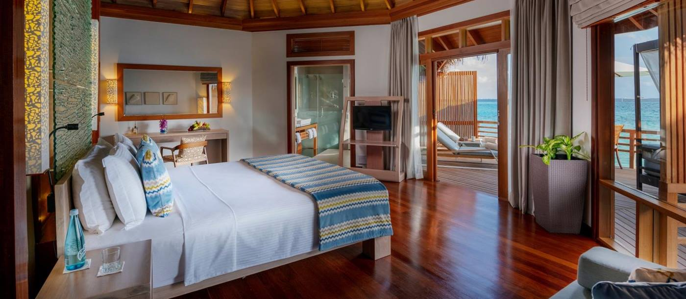 Bedroom of Water Villa at Baros