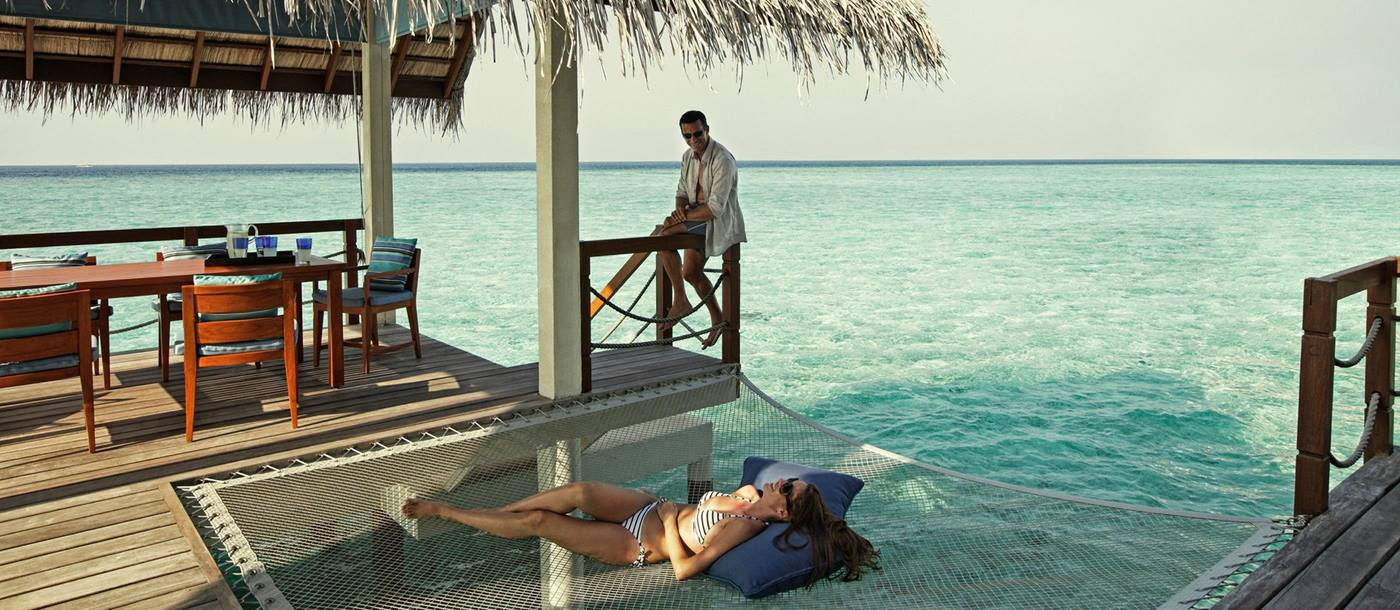 A terrace of an overwater villa at Four Seasons Landaa Giraavaru, Maldives