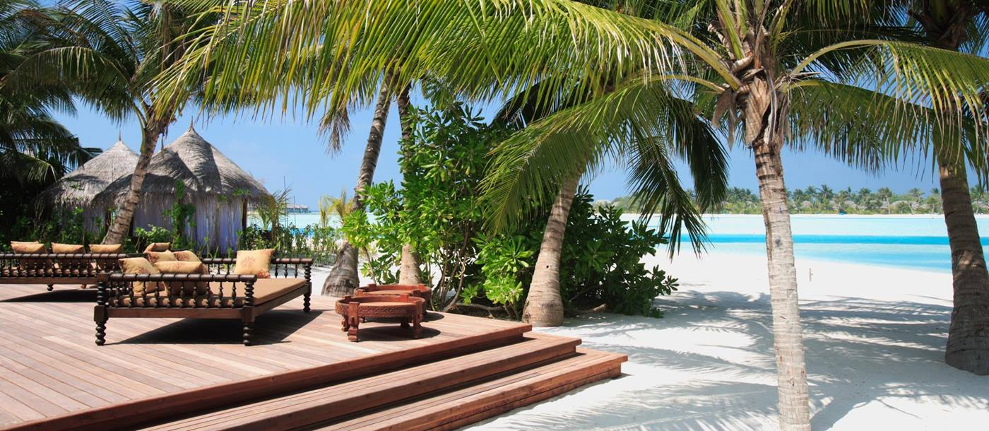 A living room deck at the beach of Naladhu, Maldives