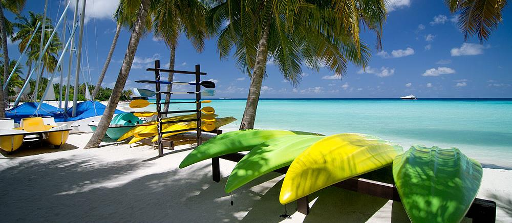 Kayaks and boards on the beach of Reethi Rah, Maldives