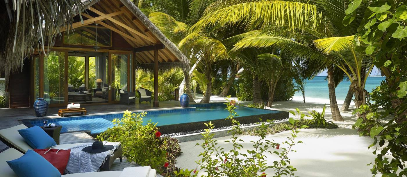 Terrace and swimming pool of a beach villa at Shangri La Villingili, Maldives