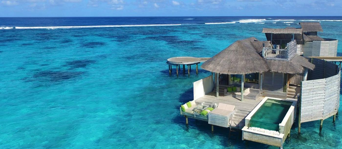 Aerial view of a Water Villa with a Pool at Six Senses Laamu