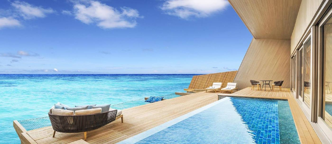 The swimming pool of an overwater villa at St Regis Vommuli, Maldives