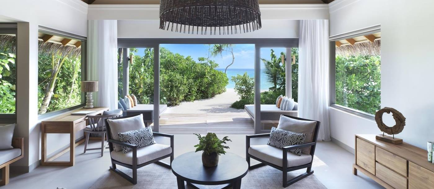 Living room at deluxe beach pool suite with views out to the ocean