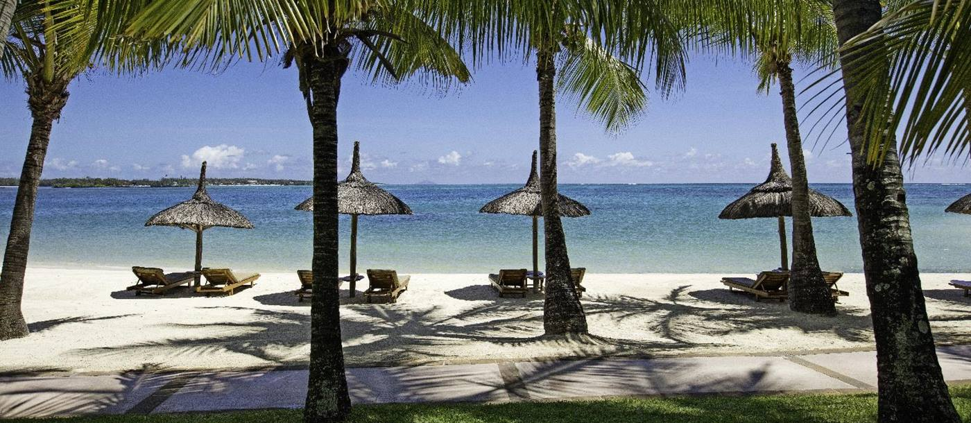 beachfront and parasols at COMO Le Saint Geran, Mauritius