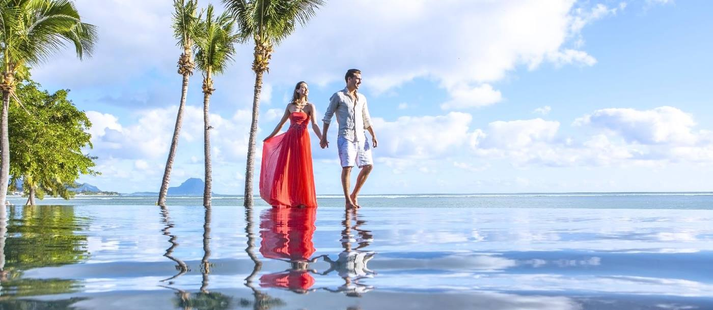 reflection of a couple in the infinity pool at Maradiva Resort, mauritius