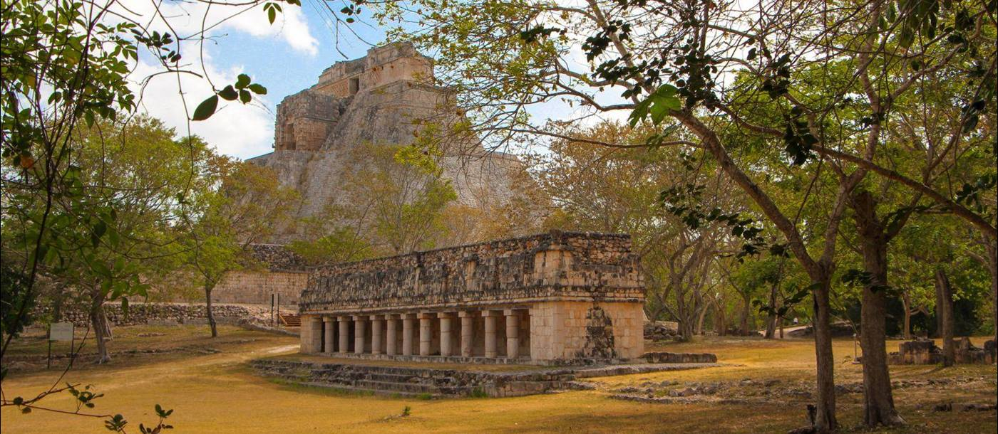 A temple at the ancient Mayan town of Uxmal with the hills of Puuc in the background