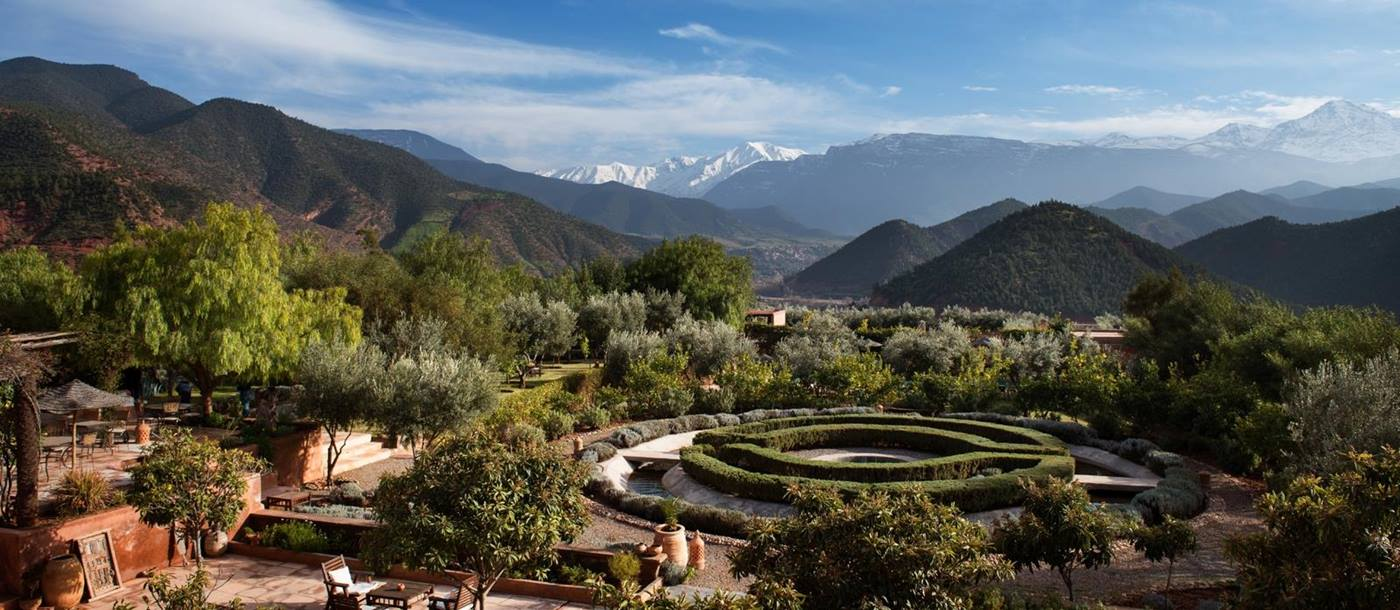 Manicured gardens at Kasbah Bab Ourika with views over the Atlas Mountains