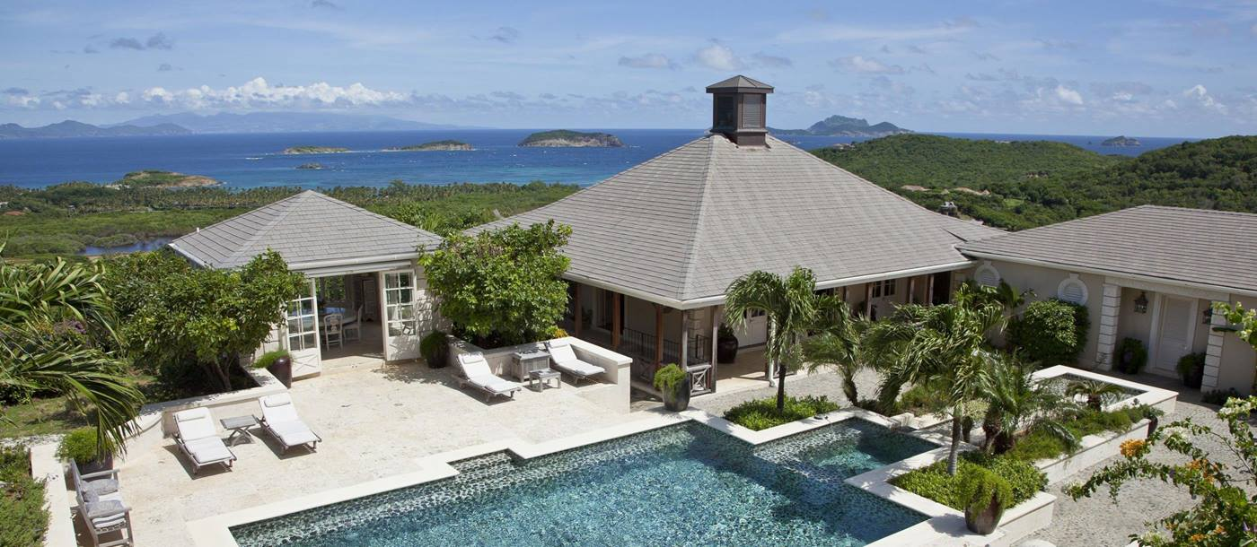 Pool area and exteriors of Aurora, Mustique