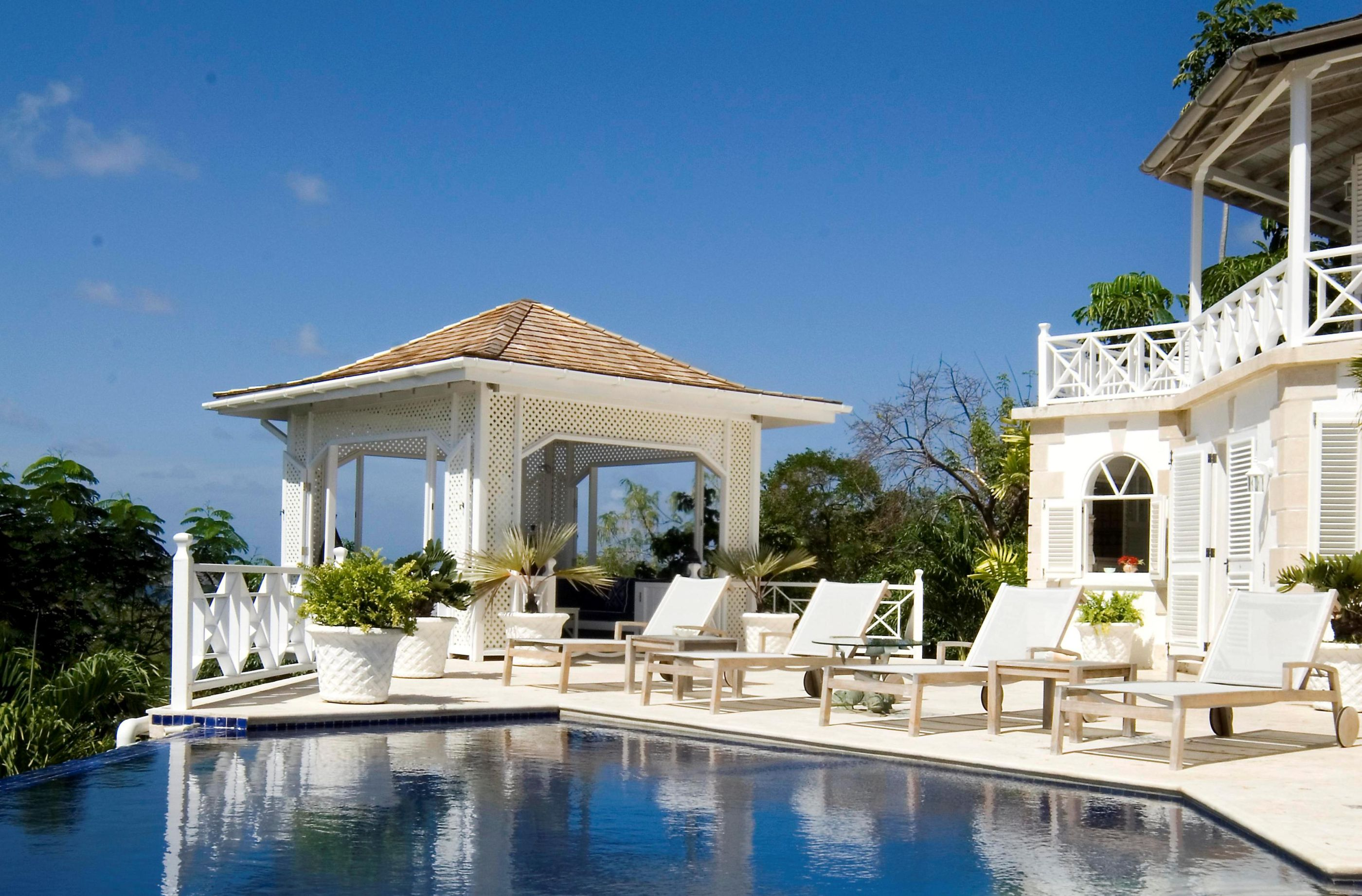 wimming pool and pool house with sun loungers at Callaloo, Mustique
