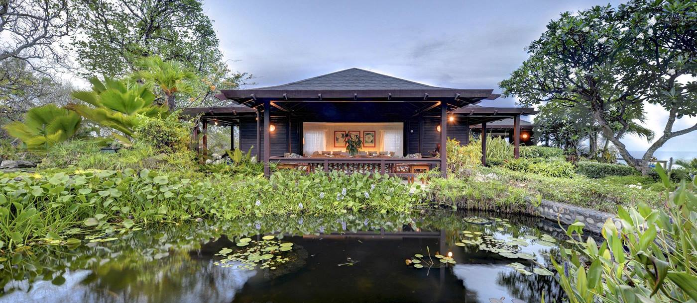Garden with pond and facade of Emerald Hill, Mustique