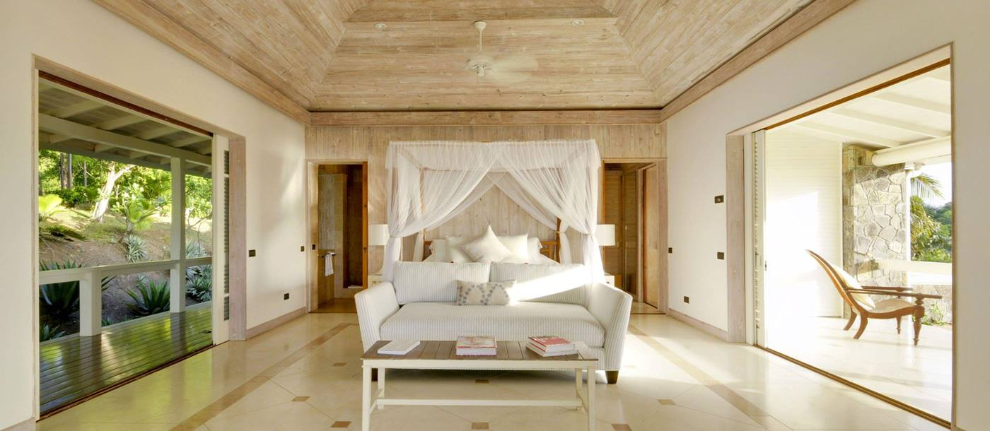Double bedroom with terrae and balcony access at Full Moon, Mustique