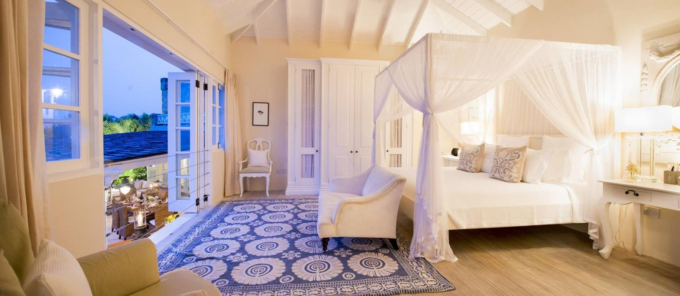 Wooden double bedroom of Greystone Cottage, Mustique