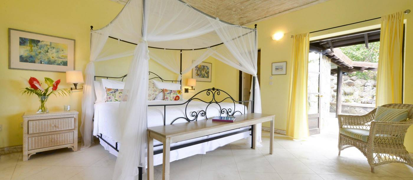 Yellow double bedroom in Seafan, Mustique