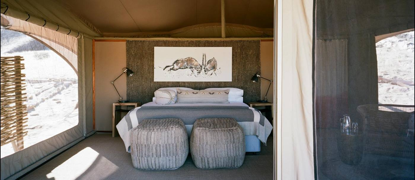Tented bedroom with animal drawing over bed