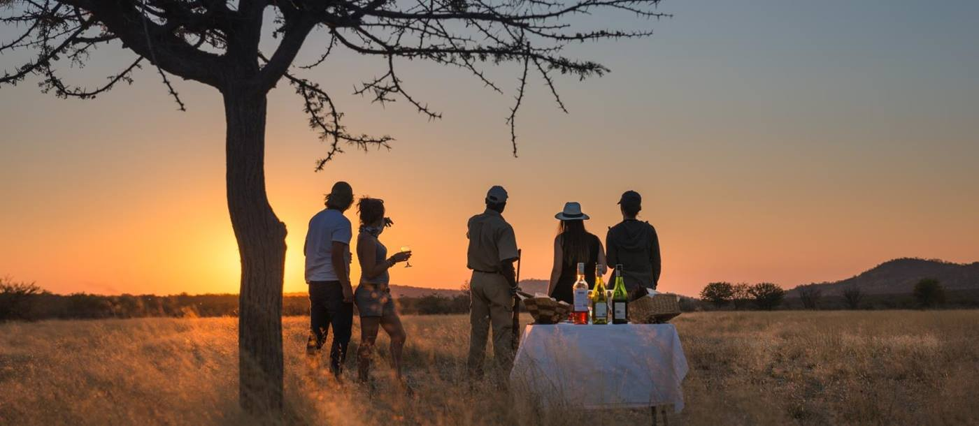 Sundowners under a tree at Little Ongava