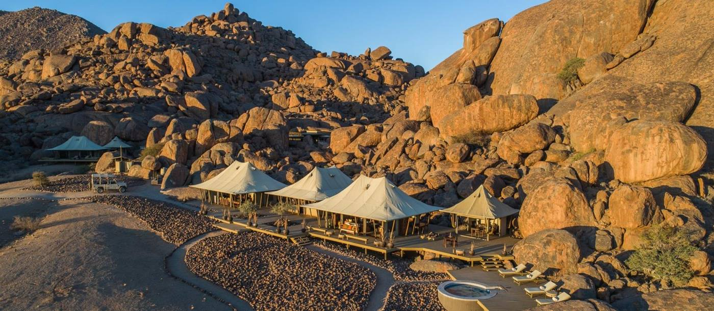 Aerial view of the camp set against boulders at sunset