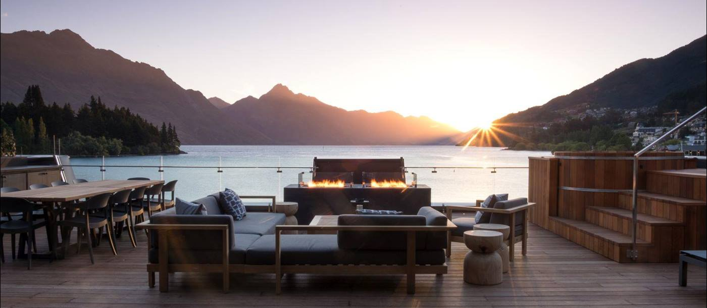 Eichardt's Private Hotel New Zealand Penthouse terrace overlooking the lake with outdoor seating