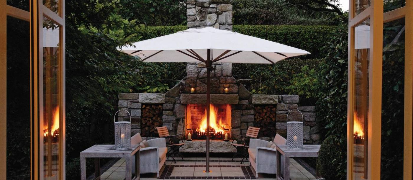 The outdoor fireplace of the owners cottage at Huka Lodge, New Zealand