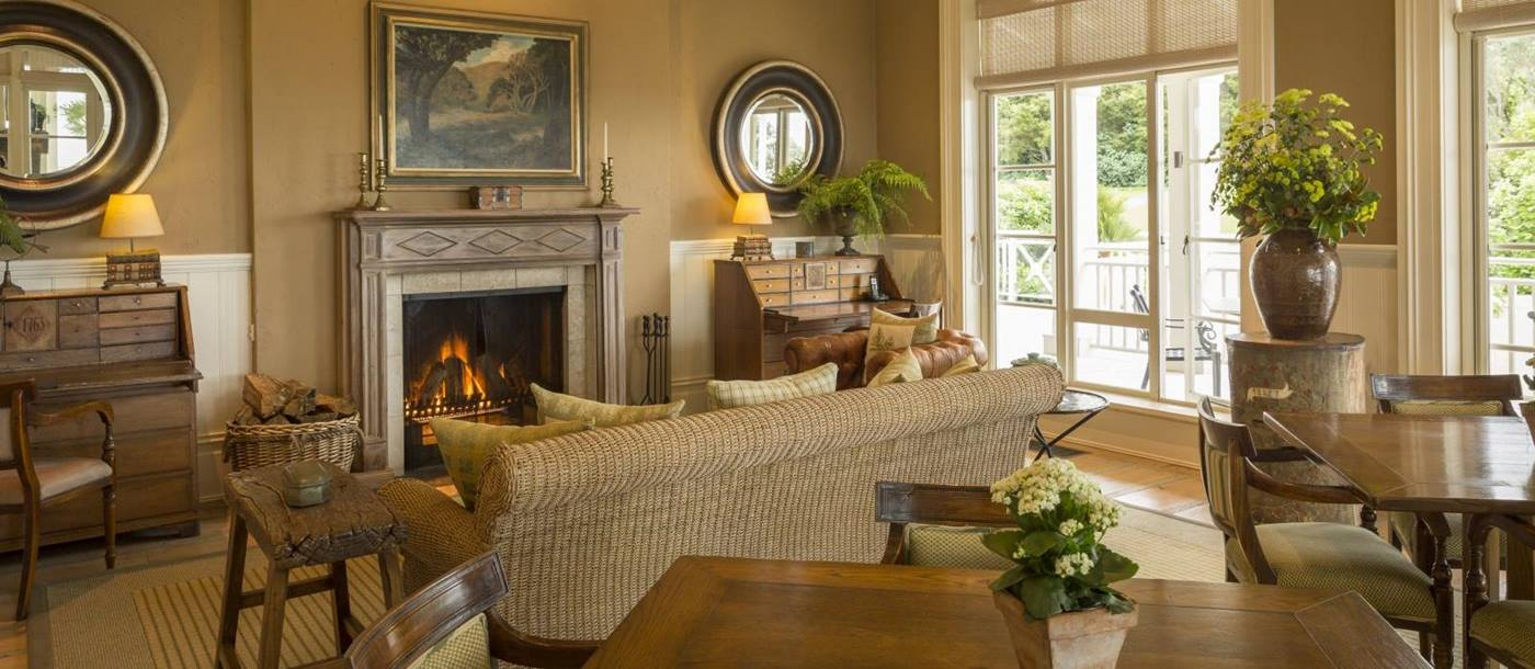 Cosy lounge at Kauri Cliffs with a fireplace