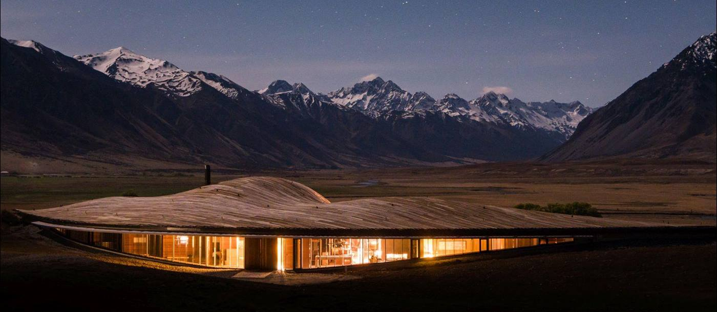 The exterior of The Lindis Lodge in New Zealand at sunset