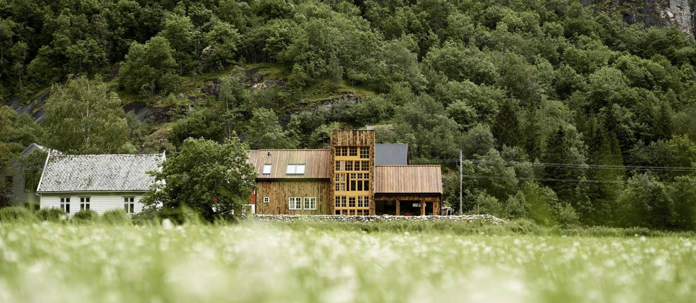 View of exterior from fields at 29-2 Aurland in Norway