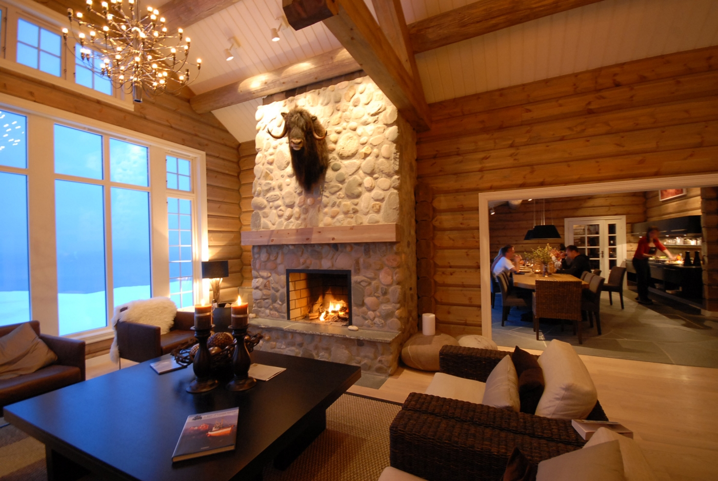 Cosy lounge area with fireplace at Lyngen Lodge in Norway
